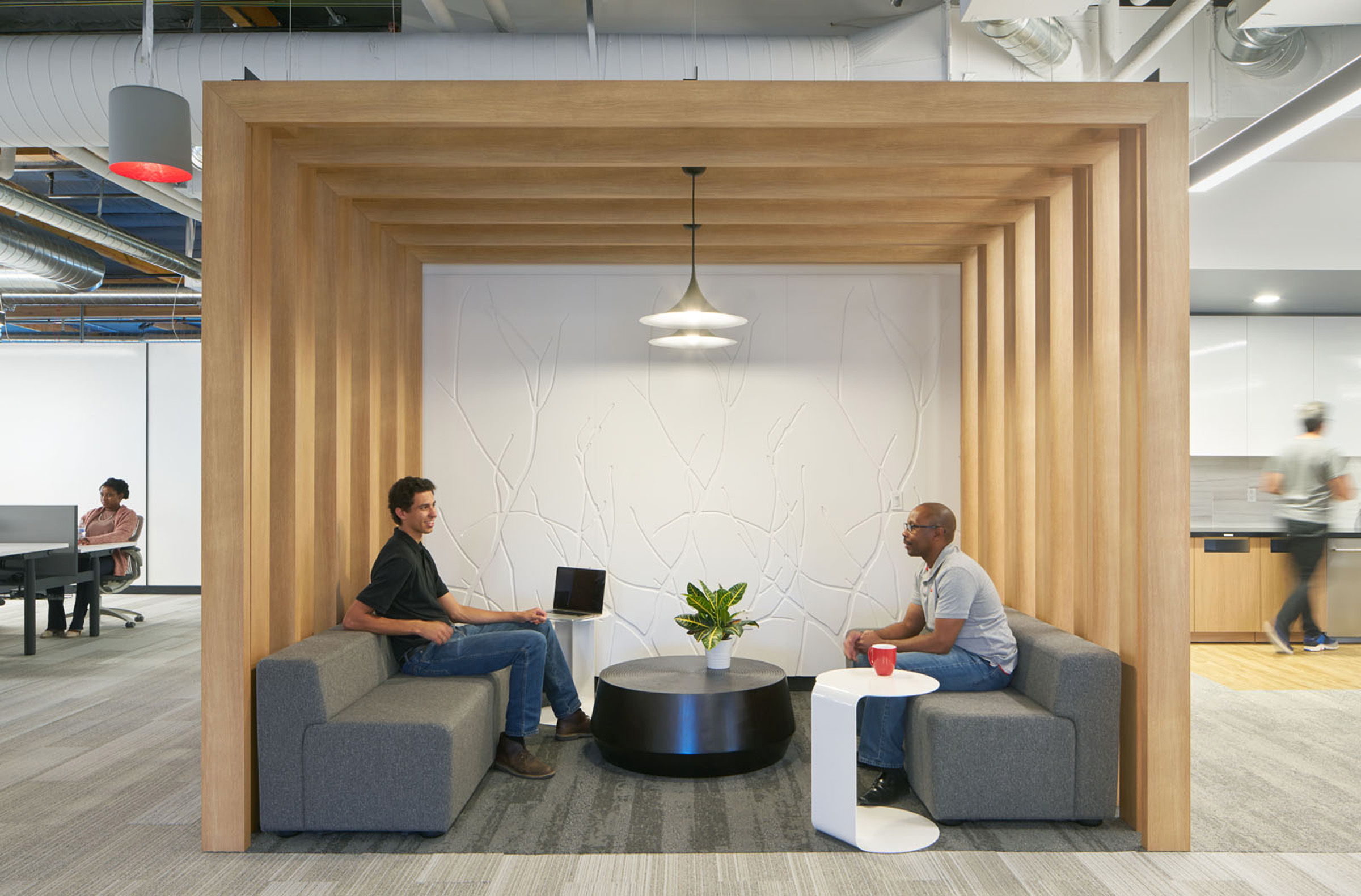 Fortina as architectural space dividers, ceiling interest, and impromptu meeting areas. Northland Control. Finish is Axis Oak.
